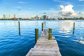 Old Wooden Pier With View To Modern Skyline Of Miami