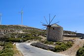 picture of wind wheel  - A new and old wind mill farm in Greece - JPG