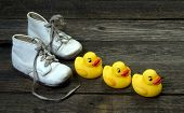 stock photo of baby duck  - Baby fun with yellow rubber ducks in a row - JPG