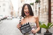 Beautiful Asian Woman Smiling Outdoor City Street With Clapperboard