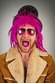 stock photo of lunate  - Cool pink haired bearded bum lunatic man - JPG