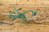 pic of plowing  - Antique riding plow for plowing a garden is drawn by a team of two horses - JPG