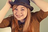 stock photo of mad hatter  - Tramp girl wears old top hat in vintage photo style - JPG