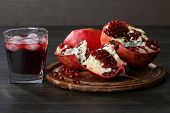 stock photo of pomegranate  - pomegranate juice with ice and red pomegranate fruit - JPG