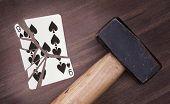 Hammer With A Broken Card, Nine Of Spades