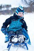 Happy Boy Sledding In Winter