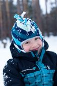 Smiling Boy In Winter