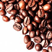 Roasted Coffee Beans Isolated On A White Background. Closeup, Macro.