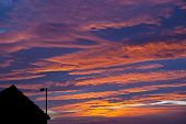 Sunset Sky With Streetlight And Rooftop