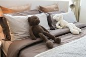 Kids Room With Dolls And Pillows On Bed At Home