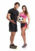 Athletic Couple - Man And Woman With Ball On The White