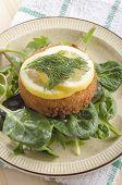 Fish Cake With Lemon Slice On Green Salad