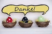 Three Colorful Easter Eggs With Comic Speech Balloon With Danke Means Thank You