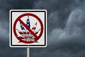 stock photo of marijuana leaf  - Driving Under the Influence of Marijuana A road highway sign with a marijuana leaf in USA flag colors with stormy sky background - JPG