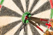 image of bullseye  - Darts board with three arrows in bullseye - JPG