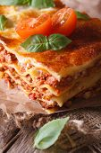 Hot Lasagna With Basil And Tomatoes On An Old Table, Vertical