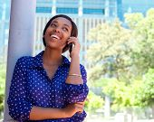 Happy Young Black Woman Calling By Mobile Phone
