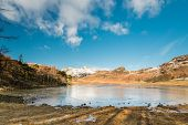 Blea Tarn With Snow Covered Side Pike