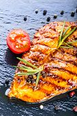 image of  breasts  - Steak chicken breast olive oil cherry tomatoes pepper and rosemary herbs - JPG