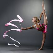 Rhythmic gymnast doing vertical split with ribbon