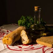 jar with olive oil and ciabatta bread