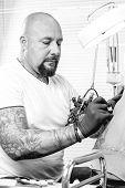 Male Tattooer Tattooing A Back.