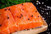 Fresh Salmon Fillet With Pepper And Sea Salt Closeup