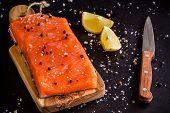 Fresh Salmon Fillet With Lemon, Pepper And Sea Salt