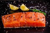 Fresh Salmon Fillet With Lemon, Peppr And Sea Salt