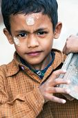 Nepalese Boy With Bricks