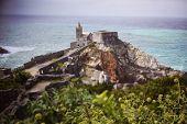 stock photo of cliffs moher  - Castle ruins on cliff in Ireland near ocean - JPG