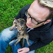 image of lap  - cat sits on the man - JPG
