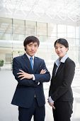 picture of korean  - Portrait of confident Korean business couple looking at camera - JPG