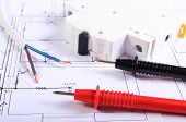 picture of electrical engineering  - Cables of multimeter electric wire and electric fuse on construction drawing electrical drawings and tools for engineer jobs - JPG