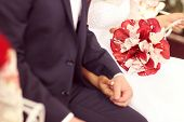 picture of calla  - Bride and groom holding hands - JPG