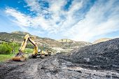stock photo of mines  - Mining machines infrastructure and coal in mountainous mine - JPG