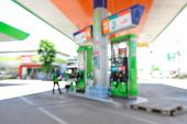 stock photo of petrol  - Blur or Defocus Background of Petrol Station at Day time - JPG