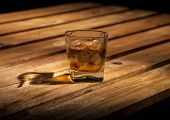 image of scotch  - Glass of scotch on wooden vintage background with copyspace - JPG