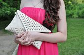 stock photo of clutch  - young girl in pink gown keeps clutch - JPG
