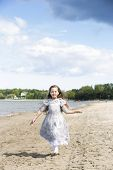 picture of polite girl  - Happy little girl running on the beach - JPG