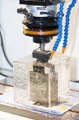 pic of ferrous metal  - CNC EDM machine making high precision mold parts - JPG