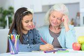 picture of grandma  - Little girl drawing wuth grandma - JPG