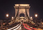 image of starry  - Budapest chain bridge glowing at starry night over the river - JPG