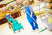 pic of supermarket  - Floor care and cleaning services with mop in supermarket shop store - JPG