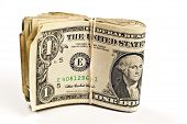 picture of bundle  - Bundle of folded dollar bills worn and tattered bound with rubber band - JPG