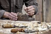 picture of workbench  - Hands Of Carpenter Plane On The Workbench In Carpentry