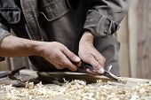 picture of workbench  - Carpenter With Chisel In The Hands On The Workbench In Carpentry - JPG