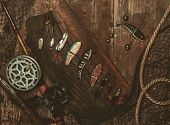 foto of fishing bobber  - Fishing tools on a wooden background - JPG