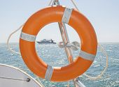 picture of life-boat  - Life ring safety equipment on a boat in tropical sea - JPG