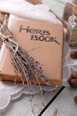 pic of roughage  - Dry lavender with nutmeg and book on table close up - JPG